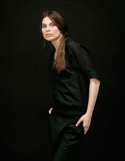 Black cotton shirt and black wool trousers with asymmetric pleat by designer Magdalena Mayrock Berlin